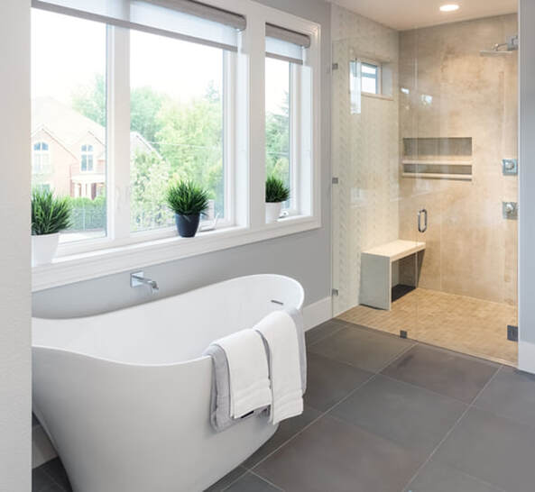 Bathtub and shower in remodeled master bathroom